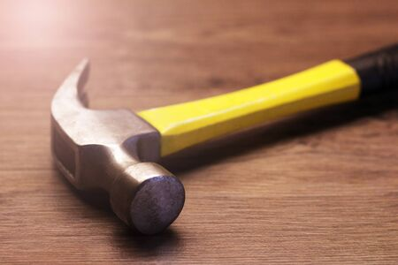Yellow hammer, a tool for construction and repair, so close Standard-Bild