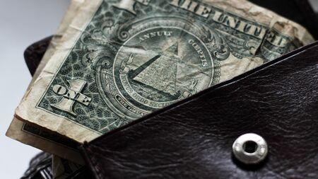 dollars bills in wallet, money so close
