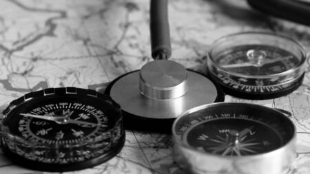 Stethoscope and compass on a map so close