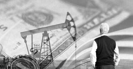 Businessman Oil pump on background of US dollar, back view Reklamní fotografie