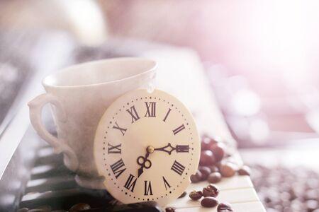 A clock with Roman numerals and a piano, retro