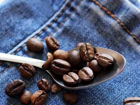 coffee beans on the metal spoon so close