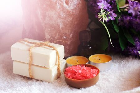 Red sea salt and purple flowers, beauty and health, style