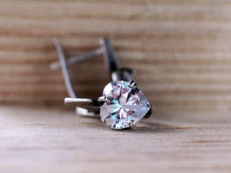 Silver diamond earrings so close, macro