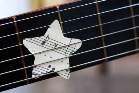 September 1, 2020. Izhevsk, Russia. A guitar with paper stars notes so close. Idea.