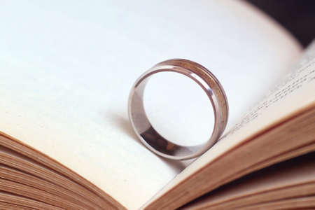Golden ring and a book so close, macro