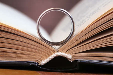 Golden ring and a book so close, macro Stock Photo