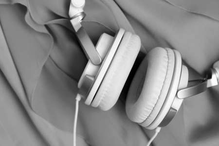 White headphones so close, black and white image, music
