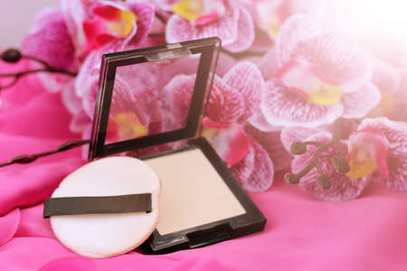 Powder for face and pink orchid, fashion cosmetic Stock Photo