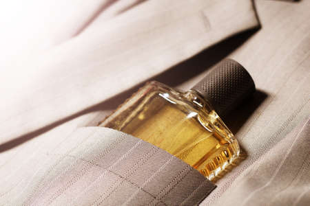 Men's perfume in the pocket of a man's jacket, fashion