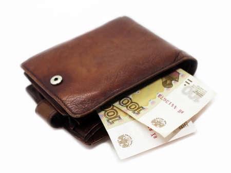 Leather men's wallet and one hundred rubles Foto de archivo