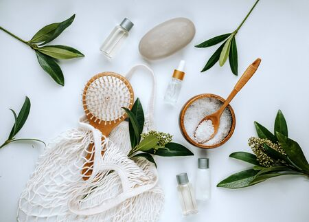 Tools for spa treatments and cosmetology. Sea salt, face serum, soap, hairbrush. Ecology concept. Eco tools