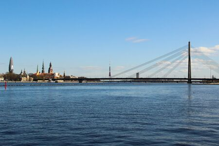 Panoramic view of opposite bank of the river Daugava. View at the Old Town of Riga and church towers. Stok Fotoğraf
