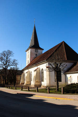 Lutheran church in Latvian town. Walk through the old town of Tukums, Latvia. Religious architecture in small towns.