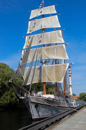 June 30, 2016. Klaipeda, Lithuania. River Dane, St. Tiltu. Meridianas ship with white sails. Editorial