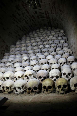 Bones and human skulls are placed in a pile at the Czech catacombs.