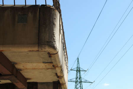 Part of an old concrete staircase. Transmission tower in the background.
