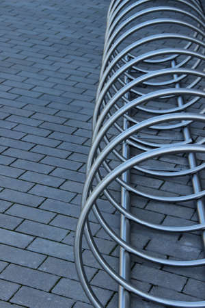 Stainless steel bicycle parking rack. Modern bicycle parking stand makes an abstract background.