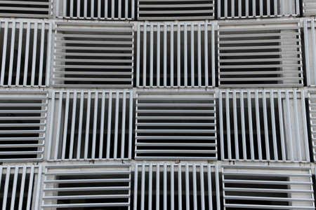 Geometric pattern background. Modern facade surface. Air ventilation at the parking lot.