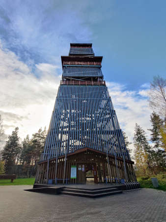 Tall wooden observation tower in the Nature reserve Tervete, Latvia. Watchtower with a staircase made of wooden beams.