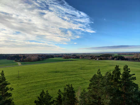 Country landscape in early autumn. Green meadows and rural scape of Europe. Farmlands in Latvia. 免版税图像