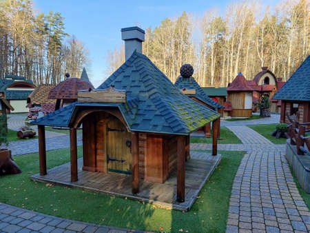 Gnome village in attraction park. Tiny dwarf houses with colorful facades. Fairy tale village and entertainment park for kids.