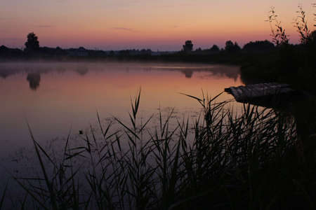 Photo of dawn on a pond with fog Stock fotó - 151147331