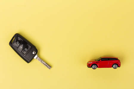 Red car and key. Concept of car loan, purchase of a new car.