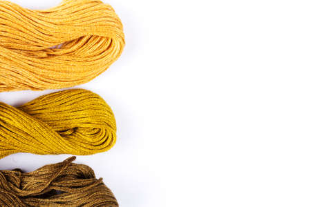 Colorful moulinet background .Bright colored skeins of floss threads on a white background.