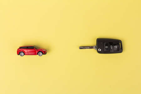 Red car and key. Concept of the automobile loan, saving money for car, trade car for cash, the concept of Finance. Archivio Fotografico