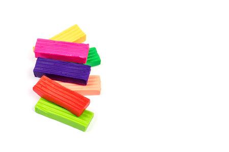 Children bright colorful plasticine isolated on white background