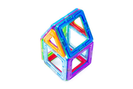 Magnetic designer for development of motor skills, thinking and imagination. Construction assembled from multi-colored parts of children's magnetic designer Banque d'images