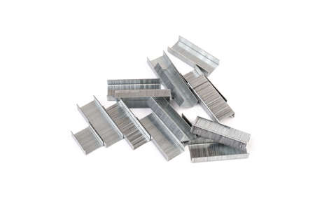 Close up stack of metal staples for stapler on a white background