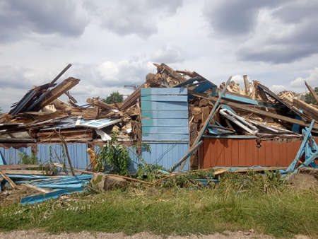 wreckage of an old destroyed wooden house, demolition of a private sector