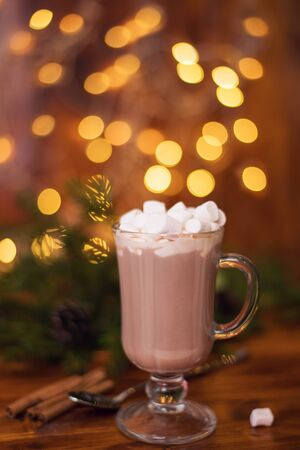 sweet cocoa in a glass with marshmallow on the background of bokeh lights, Christmas drink. Christmas decoration and bokeh of light in background Stock fotó