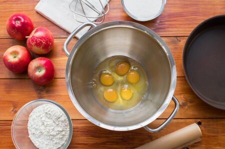 Baking concept . outumn cookies ingredients.Baking pastry and cookies: apples, spices, sugar, eggs on wood