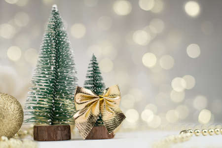 decorative Christmas trees decorated and gifts for the new year on the bokeh background, new year mood 2021