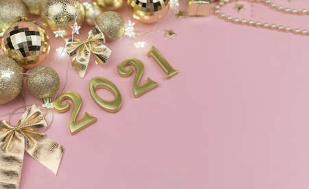 New year 2021 Golden numbers in the design of the Golden Christmas decor on a pink background