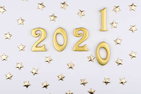 Happy New Year 2021. Sparkling gold numbers on white background with stars. object for design holiday greeting card,