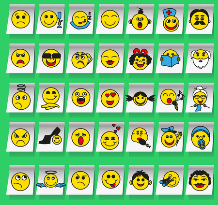 henpecked: Image of yellow smiley stickers on white on a green background.