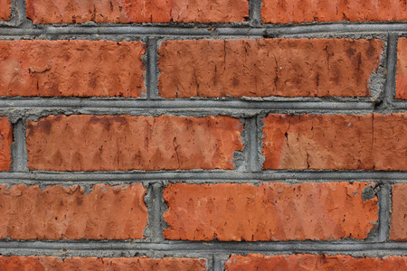 seams: Photo texture of the old cracked red brick with seams