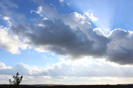 photo sky with cloud covering the sun and horizon