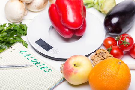 Weigh products on electronic kitchen scales and record the results. The concept of healthy eating, diet, calorie counting, eating restrictions