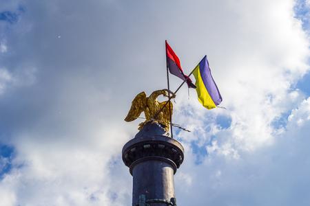POLTAVA, UKRAINE - May 15, 2018: Monument of Glory with the fixed State Flag of Ukraine and the flag of the Organization of Ukrainian Nationalists Redakční