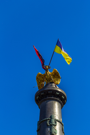 POLTAVA, UKRAINE - May 15, 2018: Monument of Glory with the fixed State Flag of Ukraine and the flag of the Organization of Ukrainian Nationalists Reklamní fotografie - 122641190