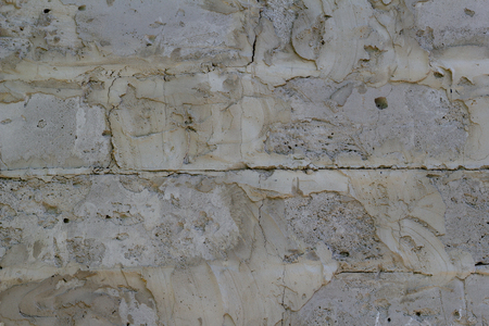 Background of gray concrete blocks of a wall texture