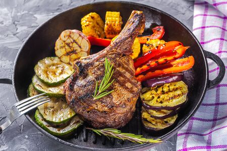 Juicy steak and grilled vegetables in a pan. Life style.