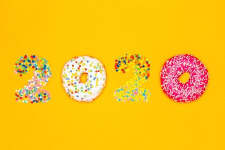 Food concept 2020 made of donuts and confectionery sprinkles. Banco de Imagens