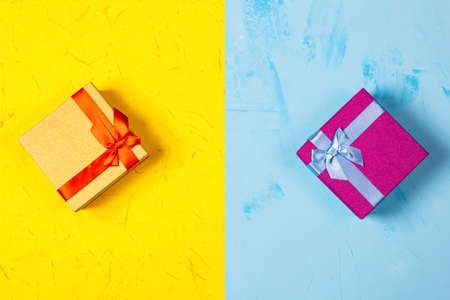 Colored square gift boxes on concrete background, flat lay, top view