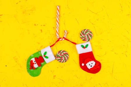 Christmas and New Years concept. Christmas Socks and lollipops, candy kane. Top view, copy space